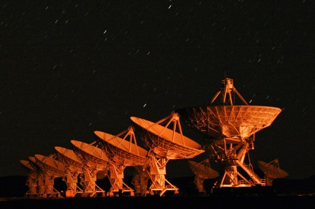 Some of the radio telescopes of the Very Large Array, seen at night,