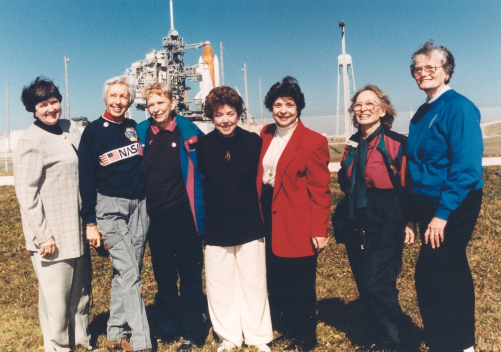 Jerri Cobb stands in front of the space shuttle, along with other women who led the quest for women in space.